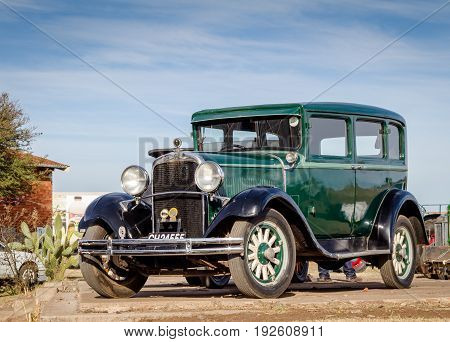 QUEENSTOWN SOUTH AFRICA - 17 June 2017: Vintage green Dodge Brothers Standard Six limousine car parked at show
