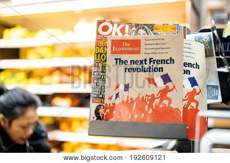 LONDON UNITED KINGDOM - MAR 8 2017: Cover of The Economist financial magazine at British press kiosk newsstand featuring headlines with the Next French revolution