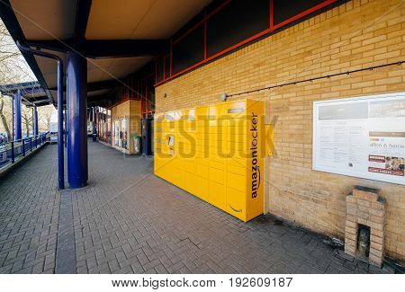 OXFORD UNITED KINGDOM - MAR 2 2017: Perspective view of Amazon locker orange delivery package locker in public place at the train station in Oxford - Amazon Locker is a self-service parcel delivery service offered by online retailer Amazon.com.