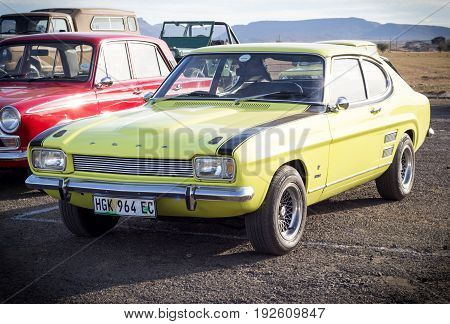QUEENSTOWN SOUTH AFRICA - 17 June 2017: Vintage Yellow Ford Capri 3000 GT parked at show