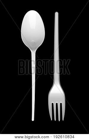 Spoon and fork on a black background