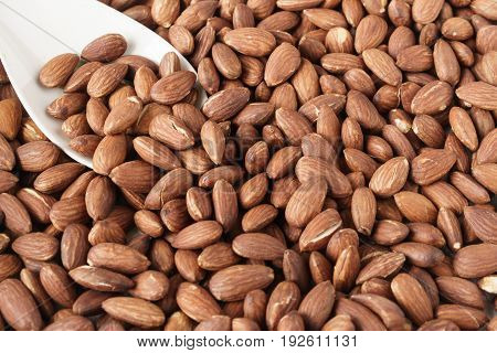 Pile of roasted almonds as a background