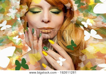 Green yellow makeup and manicure with different sharp and square shape nail art on the model with orange hair and the background with butterflies and leaves.