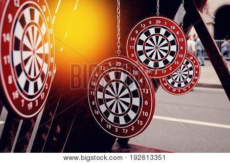 Targets for dartboard dartboard on a dark background. Concept is the choice of purpose.