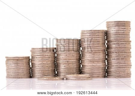 Heap of two euro coins isolated on white background