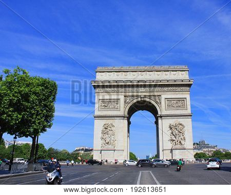 PARIS, FRANCE - JUNE 5, 2017: Arc de Triomphe popular top attraction in city of Paris, France. View from Champs Elysees street to Place Charles de Gaulle. Beautiful summer day scene with clear blue sky background.