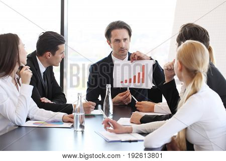 Business Man Show Graph At Meeting