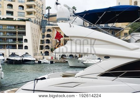 Detail of a super yacht with satellite domes and marine radar navigation system, Portomaso, Malta