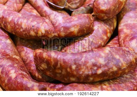 Food plat with delicious salami pieces of sliced ham sausage cooked in a traditional way.