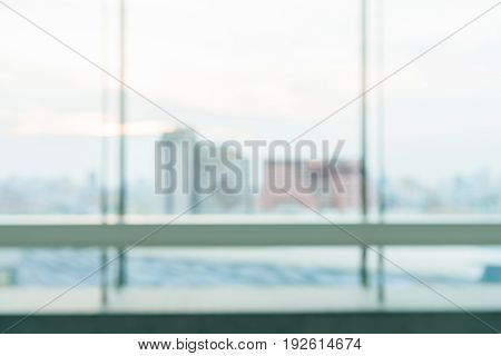 Blurred industrial city backgrounds : blur of Bangkok city town with sunset and twilight sky and bokeh light view form roof top of building . blur backgrounds concept