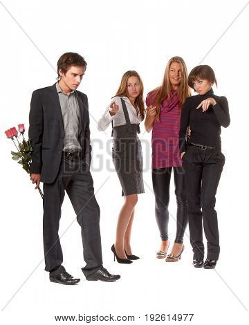The young man with a bouquet and group of girls on a white background.
