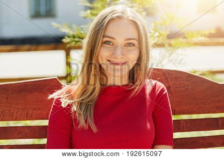 Positive Good-looking Female With Straight Blonde Hair And Pure Skin Looking Directly Into Camera Sm