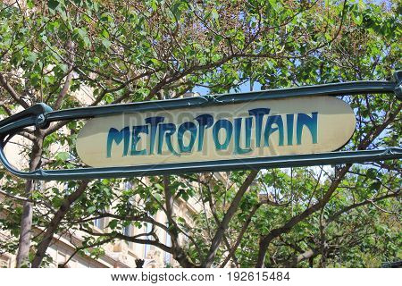 PARIS, FRANCE - JUNE 5, 2017: Metropolitain station outdoor sign in downtown Paris, France. Paris metro is a second busiest subway system in Europe, serving the city and suburbs.