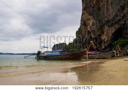 Travel To Krabi, Thailand. The View On The Long Boats On A Coast Of Sea From Railay Beach.