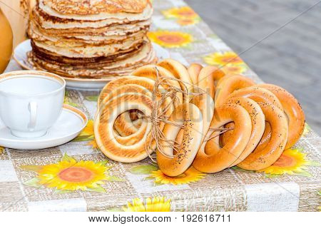 Traditional Russian food during the pancake week or maslenitsa. Pancakes and bagels on the table