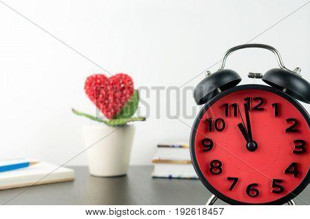 Love heart flower deadline on alarm clock concept