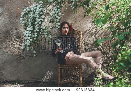 Girl With Wine Glass Sitting On Chair