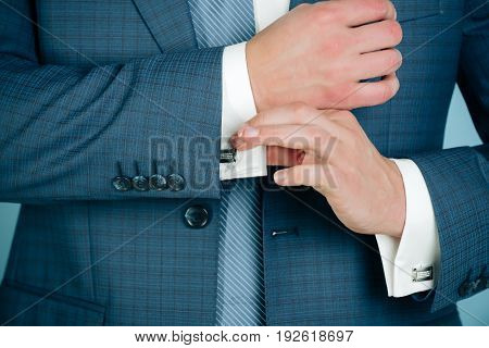 Male Hands Fixing Stylish Cufflinks On White Shirt Cuffs Sleeves