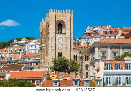 Tower bells of patriarchal Cathedral of St. Mary Major (Santa Maria Maior de Lisboa) and red roofs in Lisbon, Portugal