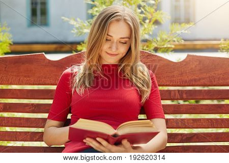 People, Hobby, Rest Concept. Young Beautiful Student Female With Straight Blonde Hair And Pure Healt