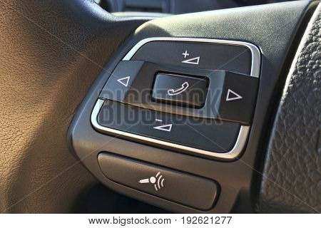 Audio Control Buttons On The Steering Wheel In A Modern Car Closeup