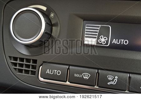 Fragment Of The Air Conditioning Control Panel In A Modern Car Closeup
