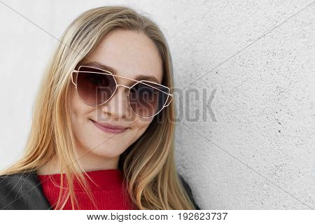 Close Up Portrait Of Pretty Woman With Fair Hair And Pure Healthy Skin Wearing Big Trendy Sunglasses
