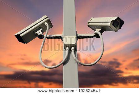CCTV camera on the post with sunset sky background.