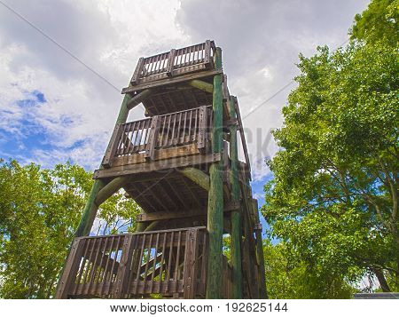 HDR Wooden tower against a cloudy sky