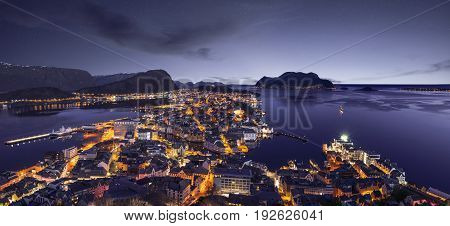 Alesund skyline panorama by night, western Norway