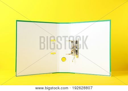 Opened Green Office Folder On Yellow Background