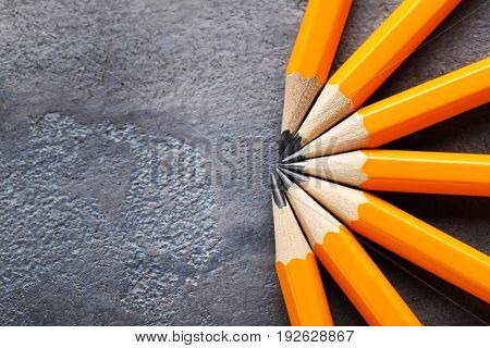 Yellow pencils on the grey wooden table