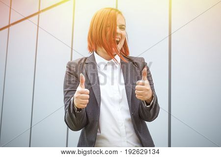 Success! Victory! Happy Successful Red-haired Girl Boss, Businesswoman In Suit Shows Gesture Class,