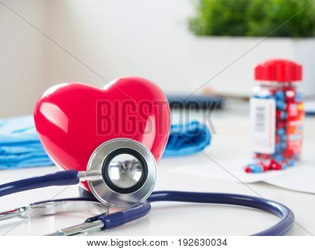 Red Heart And Stethoscope On Doctor Table