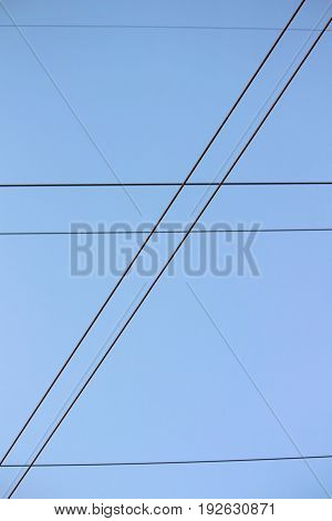 Hydro Lines Criss Crossing the Blue Sky