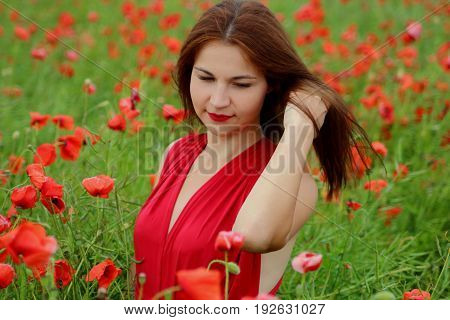 a young girl in a poppy red dress