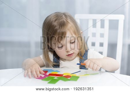 A Little Girl Remembers Geometric Shapes. Early Education Vertical