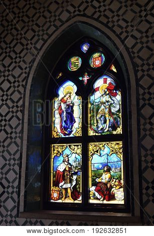 Sintra, Portugal - June 06, 2017: Stunning stained glass window on the wall in the palace of Pena Sintra Portugal. Colored pictures from the history of Portugal