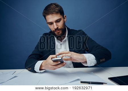 Business man working, business man with phone, business man on blue background