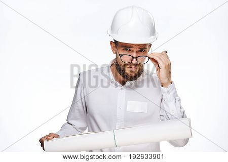 Builder in helmet, construction helmet, builder with drawing, builder wearing glasses on isolated background.