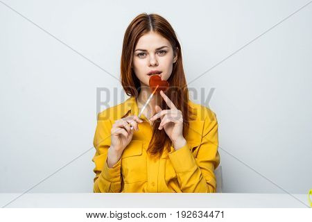 Sweets, delicious, chupa chups, woman with lollipop, lollipop, woman on gray background.