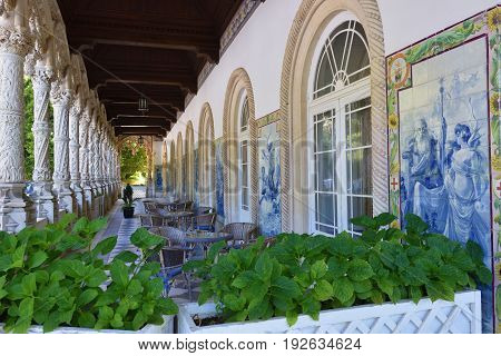 Luso, Portugal - June 10, 2017: Arched terrace with blue azulejo panel of tiles in the Bussaco Palace near Luso in Portugal