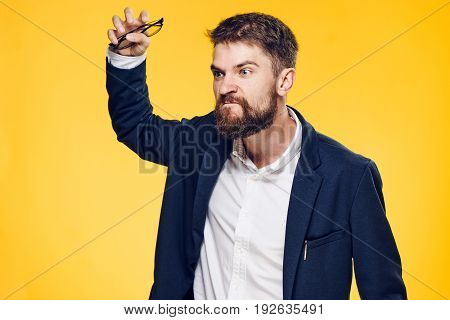 Business man with glasses, business male angry, business man on a yellow background.