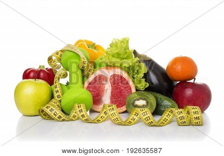 fitness equipment and healthy food isolated on white. green apple, pepper, kiwi, dumbbells and measuring tape