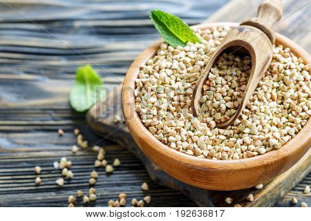 Green Buckwheat And A Scoop In A Bowl.