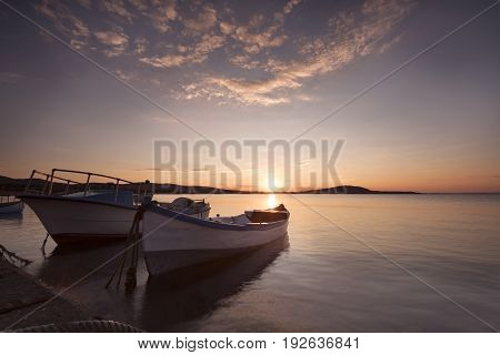 Two Traditional Wooden Fishing Boats In The Sea. Fishing Boats Tied Up In Harbor At The End Of The D