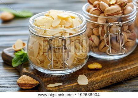 Glass Jars With Almond Flakes And Pistachios.