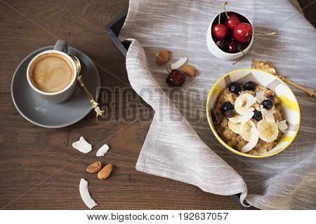 Almond Milk Quinoa With Fresh Fruits, Cherries And Coffee In A Tray. Healthy Breakfast, Lifestyle Co