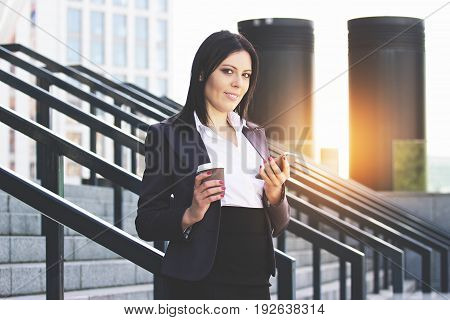 Staying In Touch With Colleagues. Portrait Of Confident Young Business Woman In Smart Casual Wear Ho