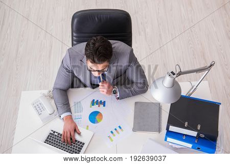 View from top on businessman working on business charts